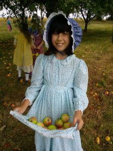 pioneer girl picking apples Singing Creek Educational Center Junction City oregon