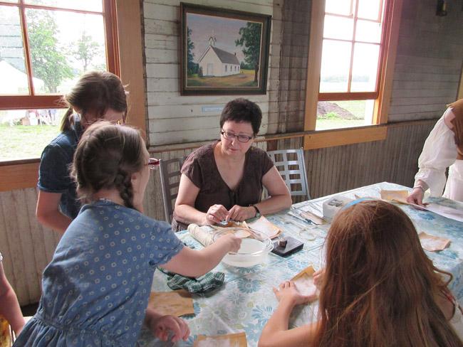 making soapstone beads Singing Creek Center pioneer