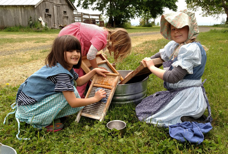 girls washing pioneer clothes farm homestead singing creek center