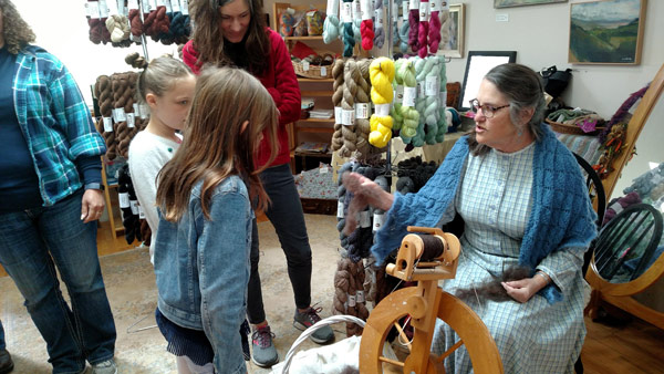 spinning-wheel-carolyn-shows-wool