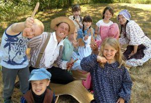 homeschool kids making wooden spoons homesteading