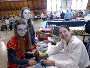 girls making corn dolls frontier heritage fair eugene oregon
