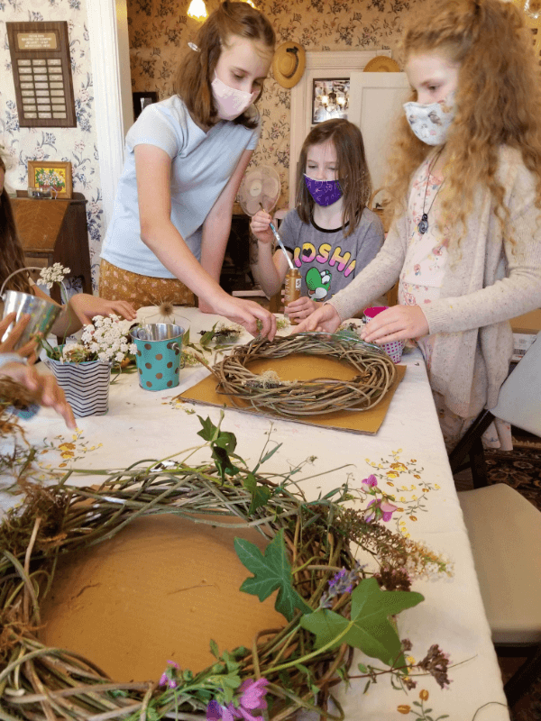 making flower wreaths summer camp