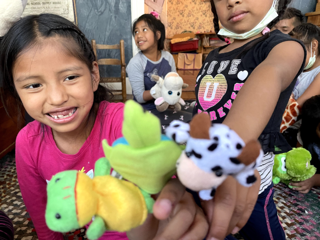 kids playing with puppets at summer camp scec
